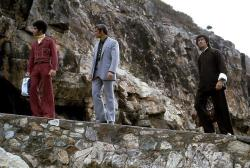 Jim Kelly, John Saxon, and Bruce Lee in Enter the Dragon.
