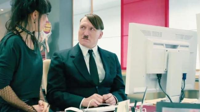 Oliver Masucci as Adolf Hitler, learning how easy contemporary technology makes it to reach a large audience in Look Who's Talking