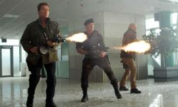 Schwarzenegger, Stallone and Willis with guns blazing in The Expendables 2.