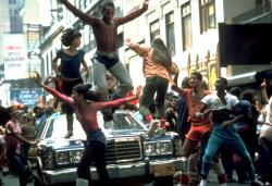 The cast of Fame performs the title number.