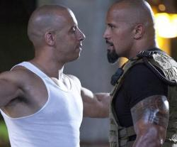 Vin Diesel and Dwayne Johnson argue over who has the sweatier bald head in Fast Five.