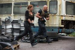 Gina Carano and Dwayne Johnson in Fast & Furious 6.