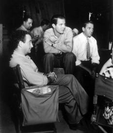Director Alfred Santell and Louis Hayward on the set of A Feather in Her Hat.