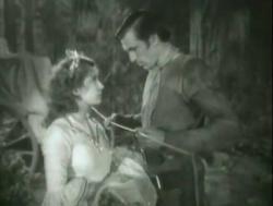 Lili Damita and Gary Cooper in Fighting Caravans.