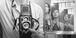 A photographic self portrait by Vivian Maier.