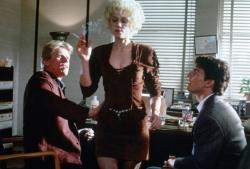 Gary Busey, Holly Hunter, and Tom Cruise in The Firm.