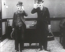 Charlie Chaplin invents the mirror image gag.