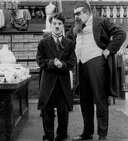 Charles Chaplin and Eric Campbell in The Floorwalker.