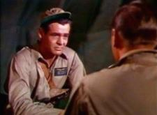 Robert Ryan talks it over with John Wayne.