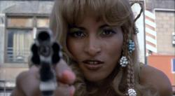 Pam Grier takes aim in Fort Apache, The Bronx.