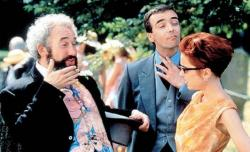 Simon Callow, John Hannah and Charlotte Coleman attend one of Four Weddings and a Funeral.