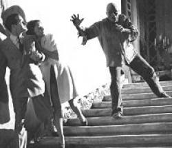 Bob Hope and Paulette Goddard run from Noble Johnson as The Zombie in The Ghost Breakers.
