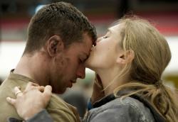 Aaron Taylor-Johnson and Elizabeth Olsen in Godzilla.