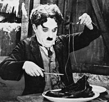 Charlie Chaplin eats his boot in The Gold Rush.