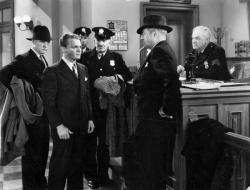 James Cagney gets roughed up and arrested in Great Guy.
