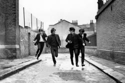 Paul McCartney, George Harrison, Ringo Starr and John Lennon do a lot of running about in A Hard Day's Night.