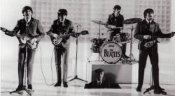 Paul, George, Ringo and John (and Paul's very clean grandfather) in A Hard Day's Night.