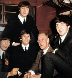 George Harrison, John Lennon, Ringo Starr, Wilfrid Brambell and Paul McCartney during the filming of A Hard Day's Night.