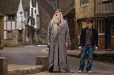 Professor Albus Dumbledore taking his favorite student, Harry Potter, on another deadly mission.
