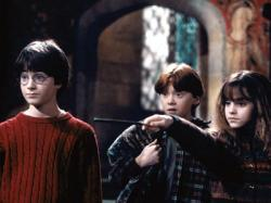 Daniel Radcliffe, Rupert Grint and Emma Watson in Harry Potter and the Sorcerer's Stone.