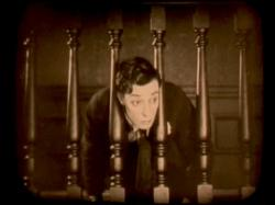 Buster Keaton gets his head stuck in The Haunted House.