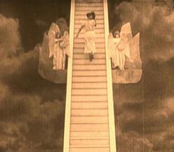 Buster climbs the steps to Heaven in The Haunted House.