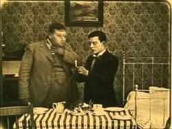 Roscoe (Fatty) Arbuckle and Buster Keaton in The Hayseed.