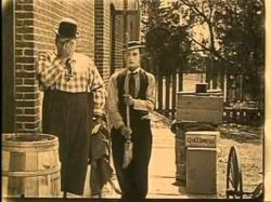 Roscoe Arbuckle and Buster Keaton in The Hayseed.