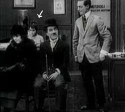 Yep, That is Gloria Swanson sitting behind Charles Chaplin in His New Job