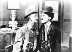Ben Turpin and Charlie Chaplin in His New Job.