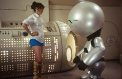 Zooey Deschanel and Marvin the Paranoid Android in The Hitchhiker's Guide to the Galaxy.
