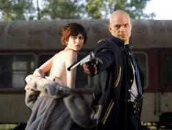 Olga Kurylenko and Timothy Olyphant in Hitman.