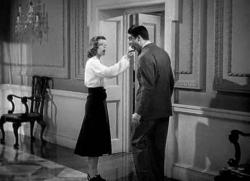 Katharine Hepburn offers Cary Grant a bite of her apple in Holiday.