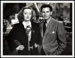 Bette Davis and John Garfield emcee at the patriotic Hollywood Canteen.
