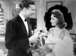 Dick Powell and Rosemary Lane in Hollywood Hotel.
