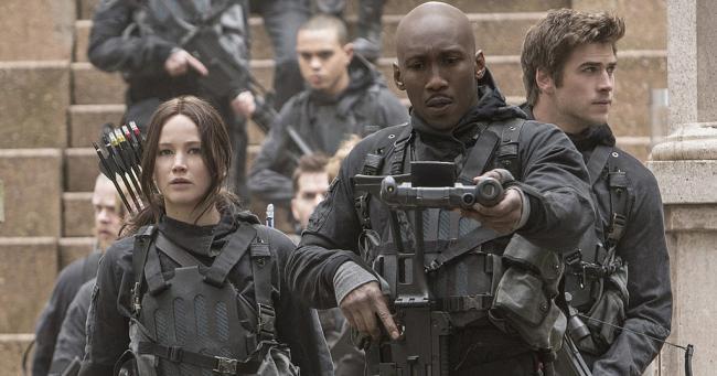 Jennifer Lawrence, Evan Ross, Mahershala Ali and Liam Hemsworth in The Hunger Games: Mockingjay - Part 2.