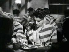 Paul Muni is a fugitive from a Chain Gang.
