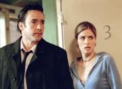 John Cusack and Amanda Peet in Indentity.