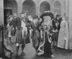 Mack Swain, Charlie Chaplin, and Edna Purviance in The Idle Class.