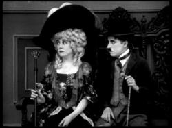 Edna Purviance and Charles Chaplin in The Idle Rich