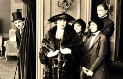 Charlie Chaplin, Edna Purviance and Lita Grey in The Idle Class.