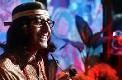 Peter Sellers as an aging hippie.