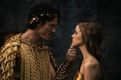 Luke Evans as Zeuss and Anne Day-Jones as Athena in Immortals.