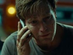 Ewan McGregor as Henry, making the hardest phone call of his life in The Impossible