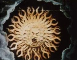 The sun swallows a train.