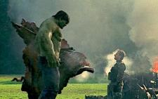 The Hulk towers over Tim Roth.