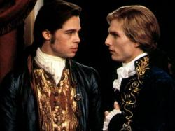 Brad Pitt and Tom Cruise, as Louis and Lestat, gaze deeply into each other's eyes in Interview with a Vampire.