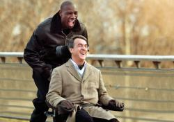 Omar Sy pushes Francois Cluzet in The Intouchables.