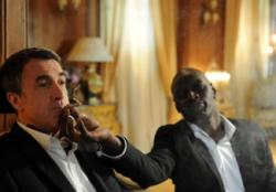 Omar Sy helps Francois Cluzet relax in The Intouchables.