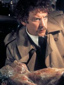Donald Sutherland and a growing pod person in Invasion of the Body Snatchers